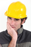 Tradesman covering his mouth