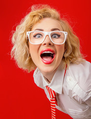 Close-up funny woman screaming, isolated on red background
