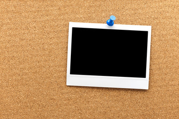 Blank instant photo frame at the cork board with clipping path