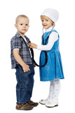 girl listens with stethoscope boy
