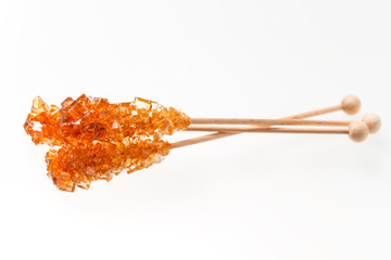 Three rocky candy sugar on a stick