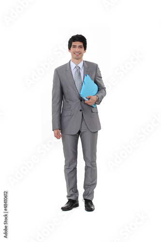 Portrait of a businessman carrying a file