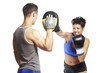 Young man and woman boxing sparring
