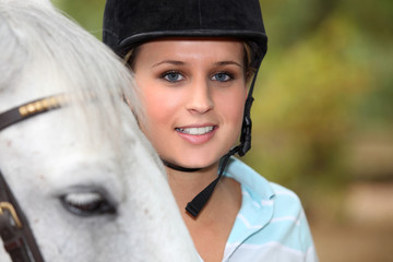 Blond female horse rider