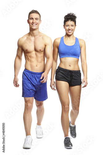 Young man and woman walking in sports outfits