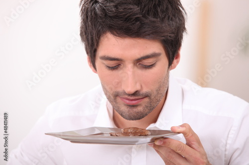Businessman smelling food on plate