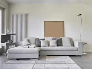 divano di tessuto nel soggiorno moderno