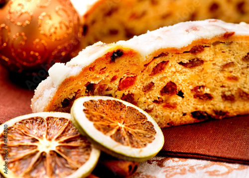 Christmas Stollen. Traditional Sweet Fruit Loaf with Icing Sugar