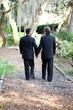 Gay Wedding Couple Walking on Garden Path