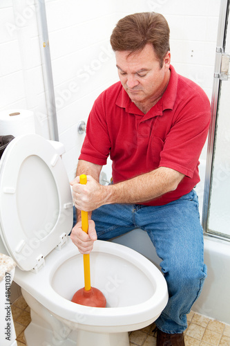 Man Uses Plunger on Clogged Toilet