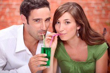 Couple drinking cocktails