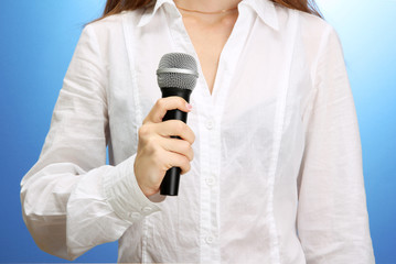 female with microphone, close up