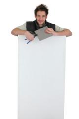 tiler holding an ad board
