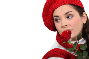 A cute woman with a rose.