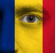 face with the Romanian flag painted on it