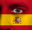 face with the Spanish flag painted on it