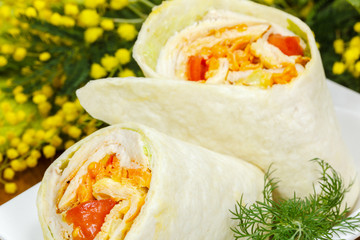 grilled chicken and vegetables wrapped in  tortilla.
