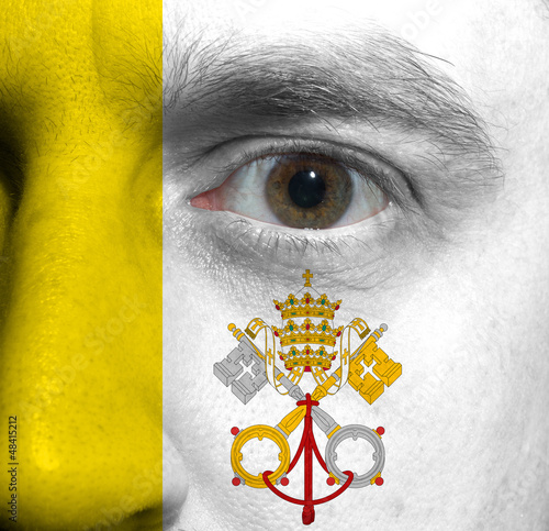face with the Vatican City flag painted on it