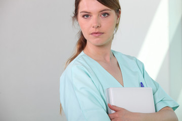 Medical assistant holding a patient file
