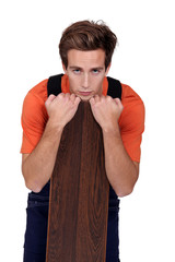 Man with a wooden plank