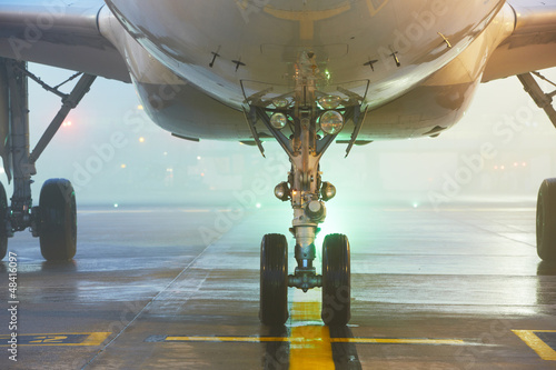Undercarriage of the airplane - Airport at the night