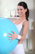 Young woman holding an exercise ball