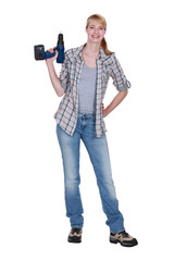 Blond woman stood with power drill