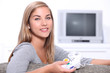 Young woman on games console
