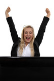 Excited blond businesswoman with laptop