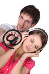 Email symbol and woman listening to music