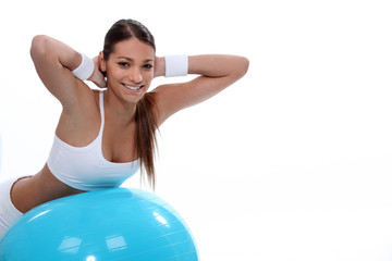 Woman in balance with ball
