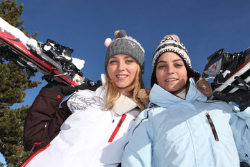 Two girls with skis