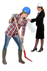 Female builder with spade