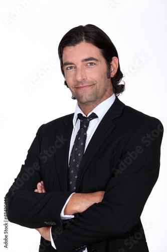 Studio portrait of a man in a suit