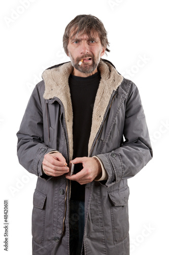 adult man lights cigarette