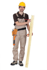 Man measuring wood