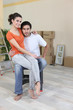 Couple sat by unpacked boxes
