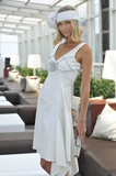 Blond fashion model wearing white couture designer clothes
