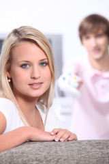 Young woman with her boyfriend playing computer games
