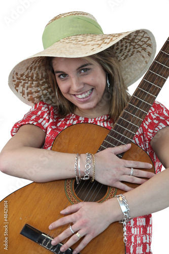 Cheerful woman holding a guitar