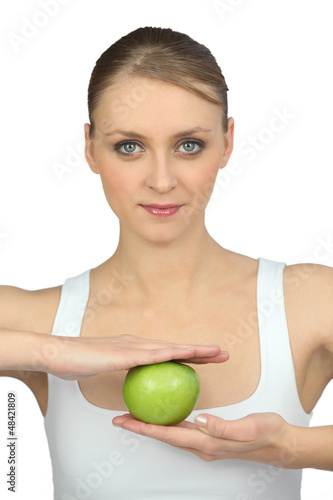 woman with apple in hands