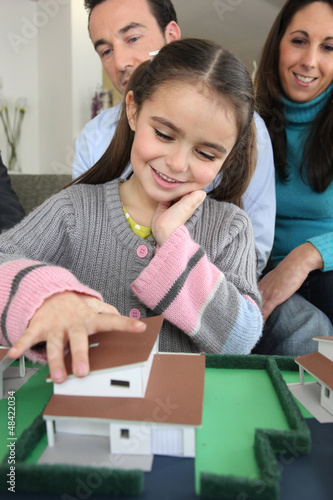 Young family with model housing