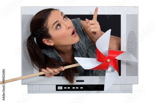 Woman escaping from television screen