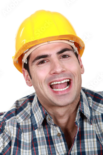 Landscape Portrait of smiling worker