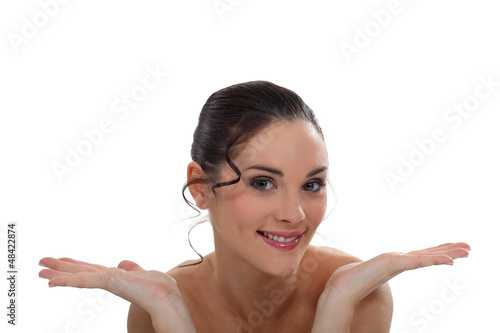 Smiling brown-haired woman on white background