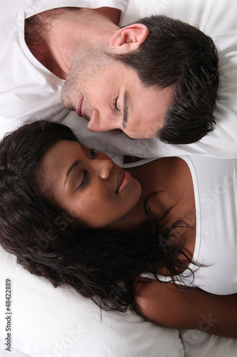 Man and woman laid in bed
