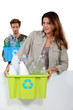 Young couple carrying plastic bottles