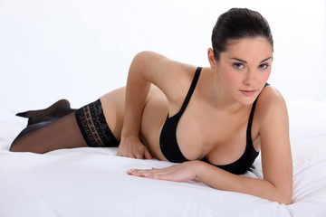 woman in sexy underwear lying in her bed