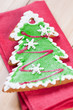 Vertical shot of a gingerbread Christmas tree on a red serviette