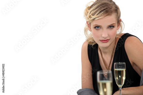 young blonde drinking champagne